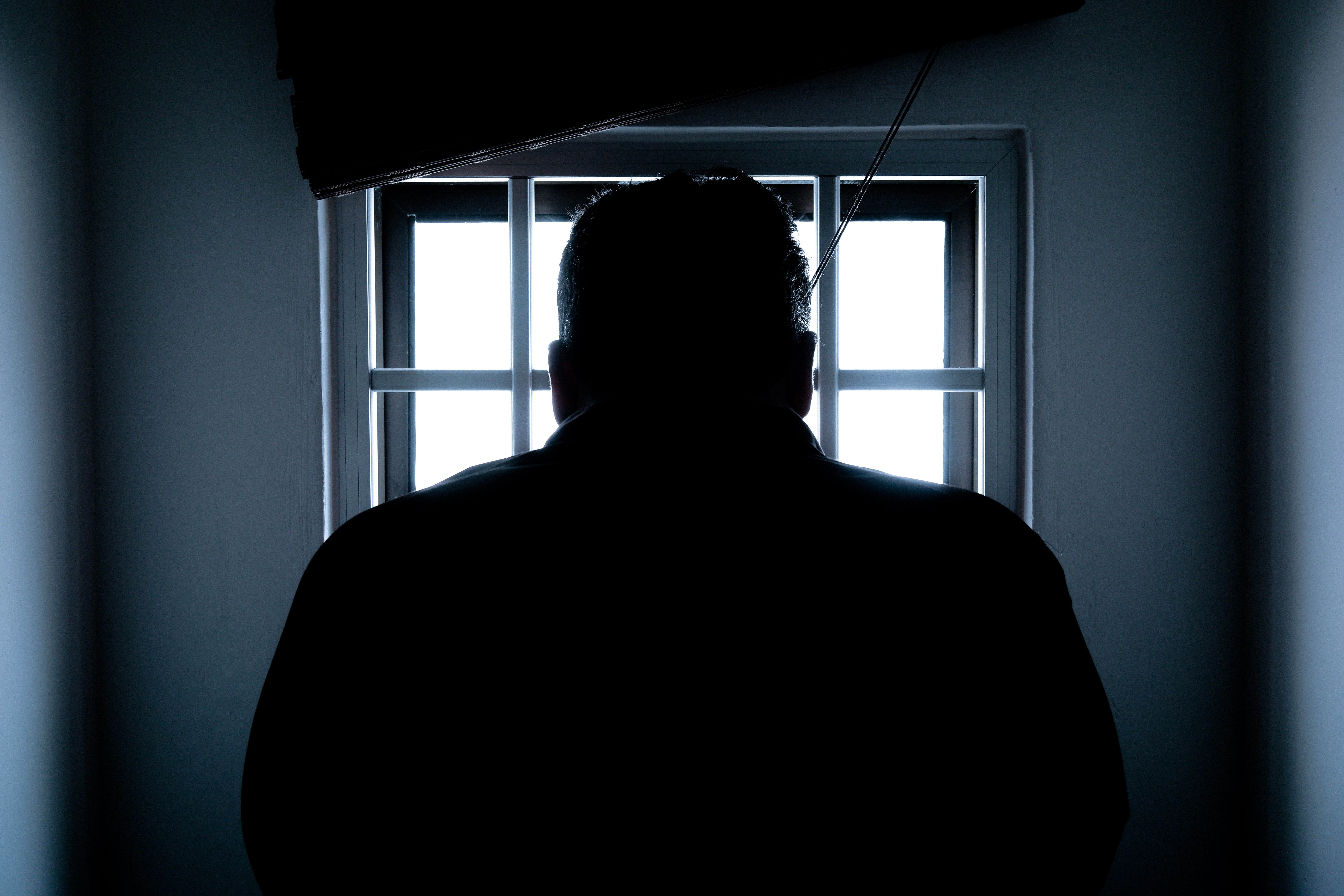 A prisoner's silhouette from behind