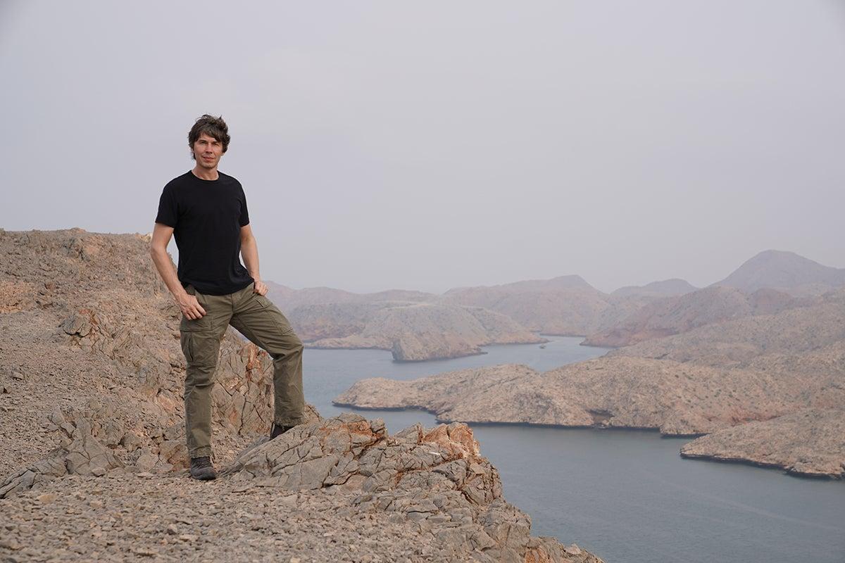 Professor Brian Cox on location at Bandar Al Khiran in Oman