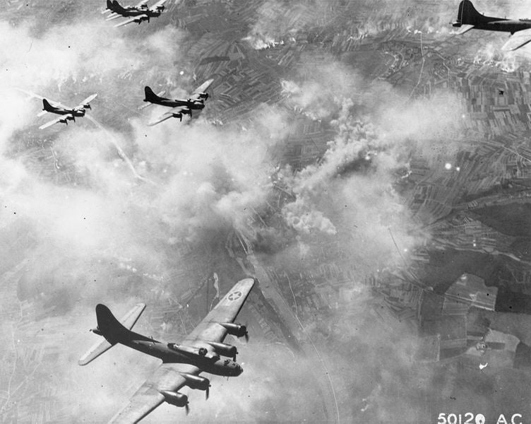 Black and white photo of allied bomber planes flying over a German target during world war 2