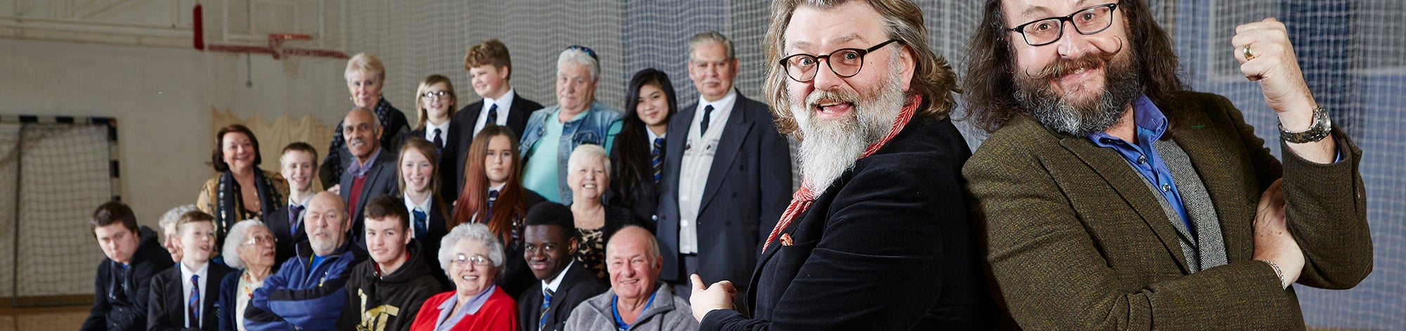 Old School with The Hairy Bikers. Hairy Bikers standing with school