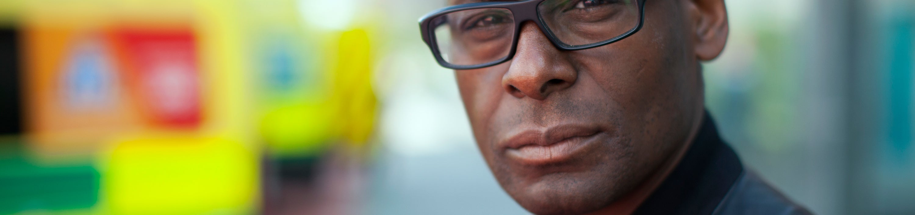 David Harewood - Psychosis and Me - David stands in front of an ambulance