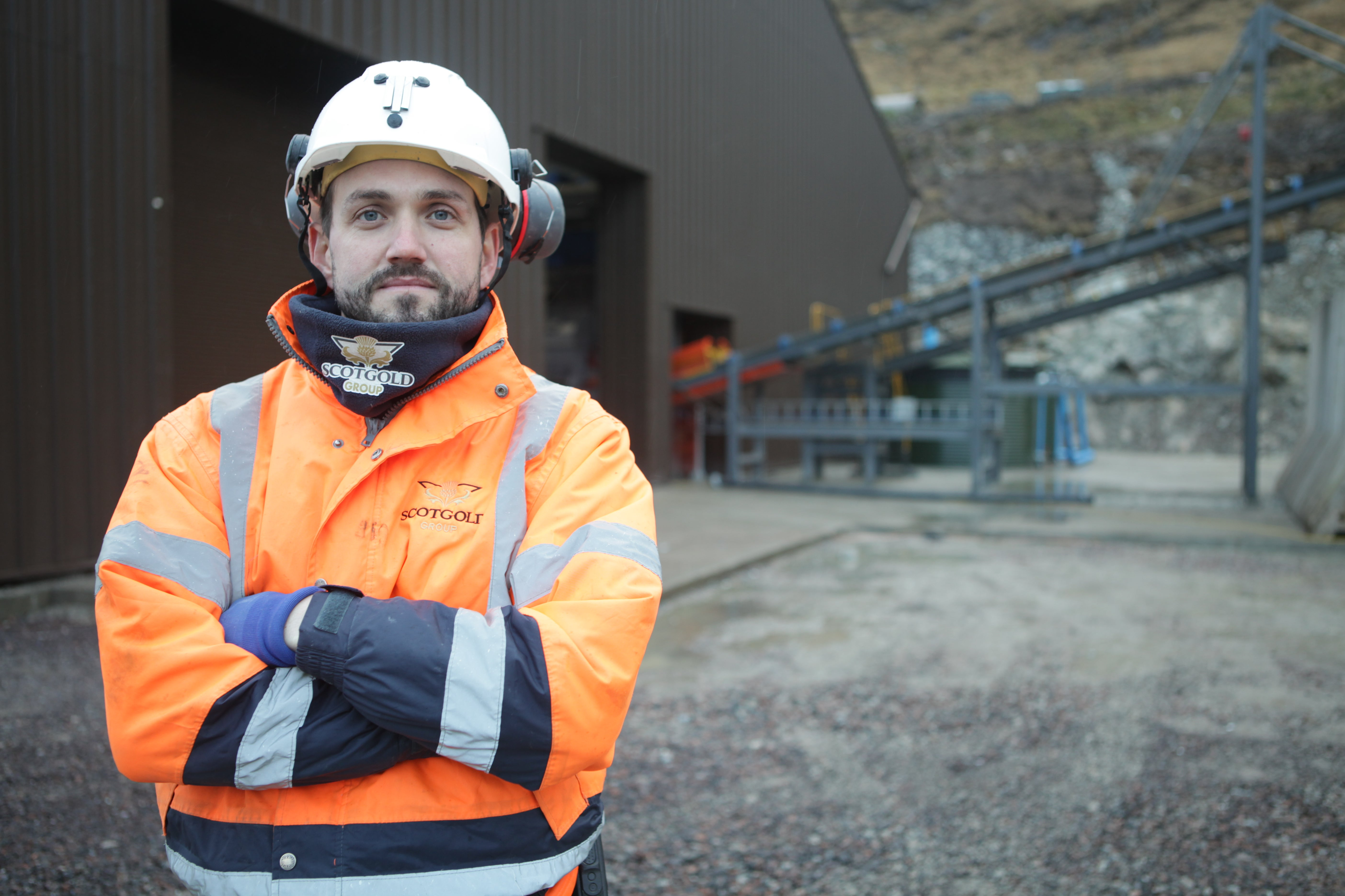 A Miner stands in front of a gold mine from BBC series Gold Town