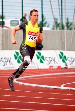 A photograph of Oscar Pistorius running on a track