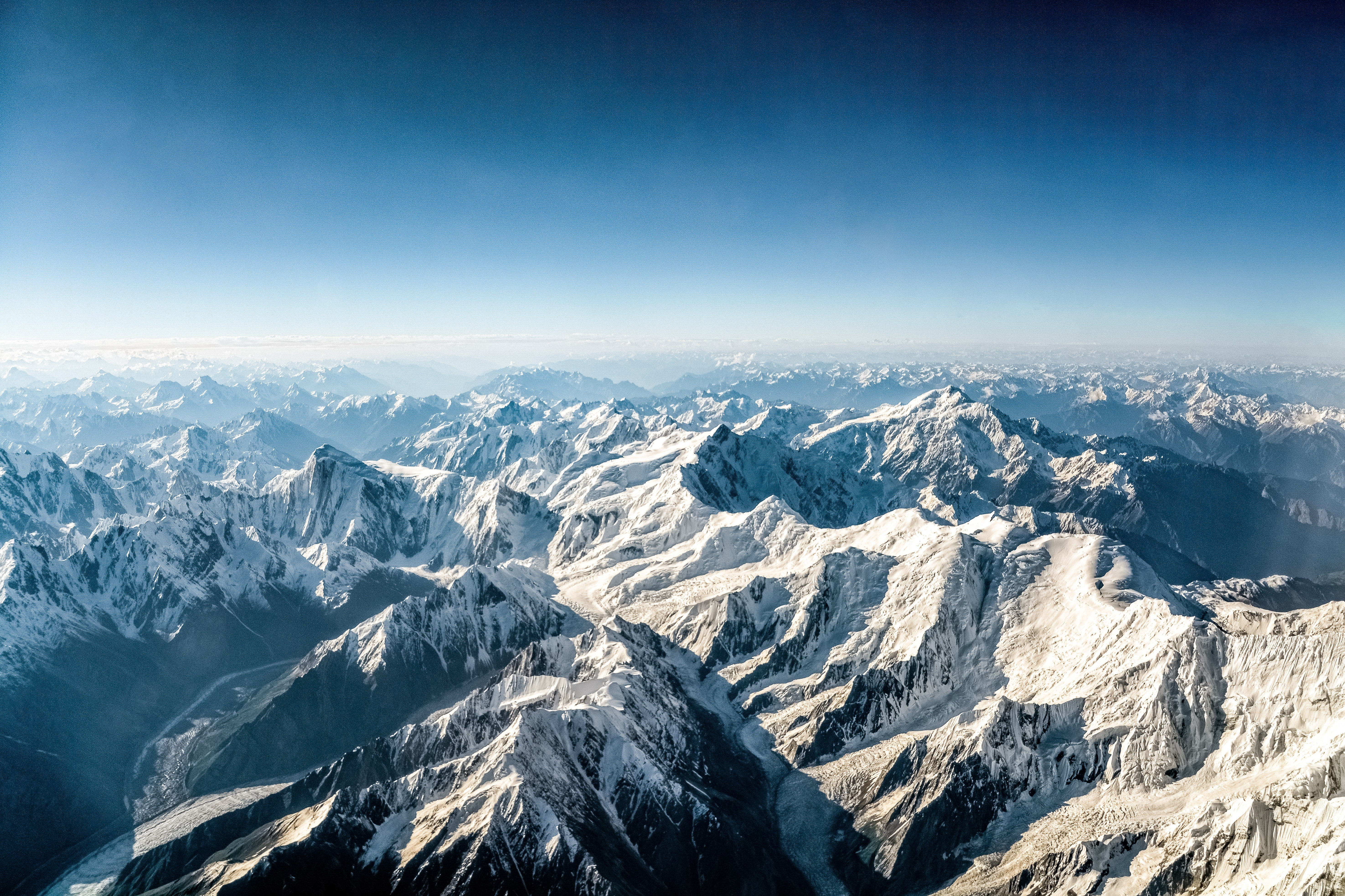 A wide vista of the Himalayan mountain landscape