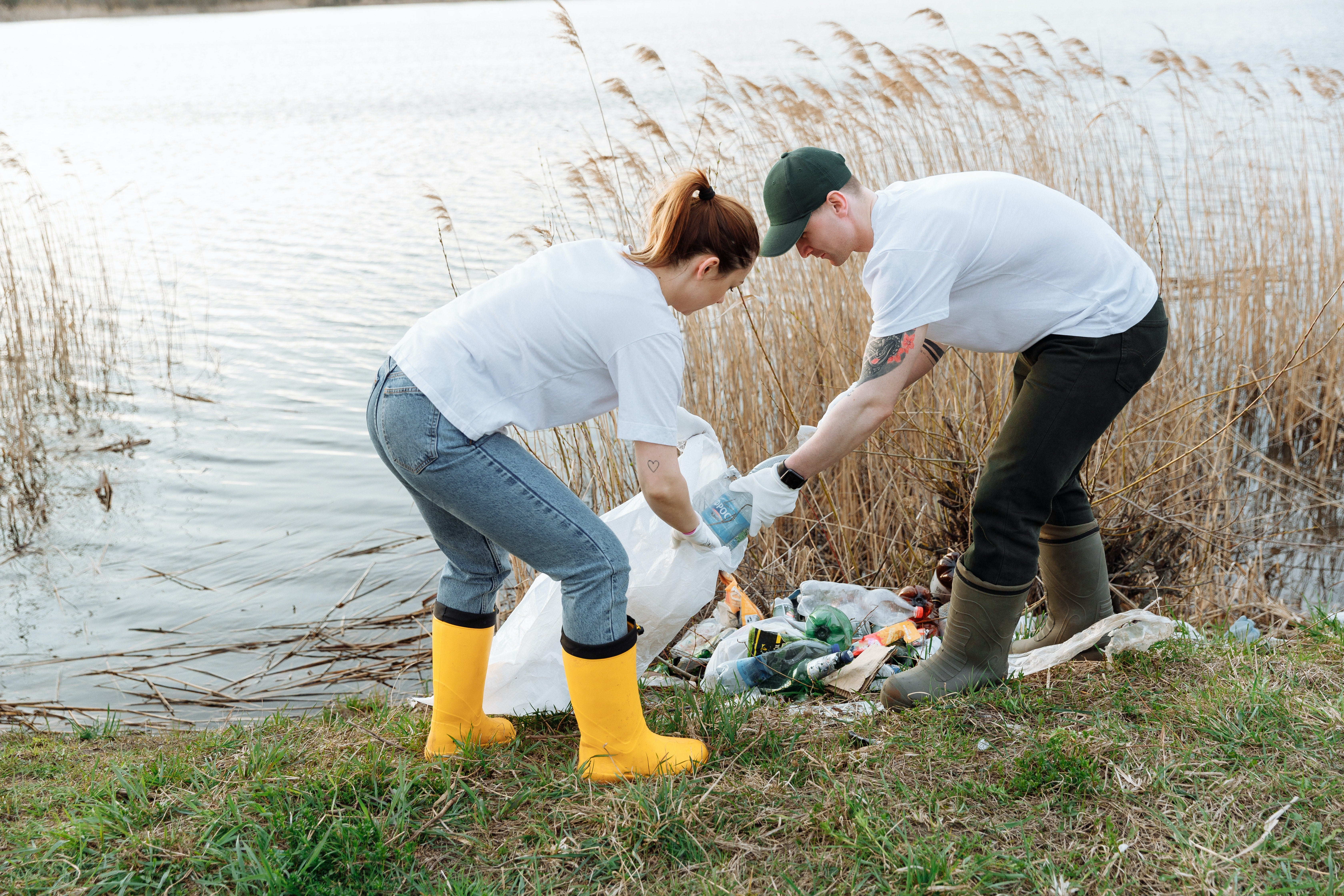 Volunteers clear rubbish from a lake