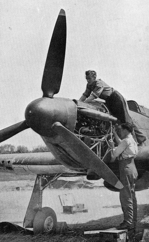 Engineers working on a Merlin engine