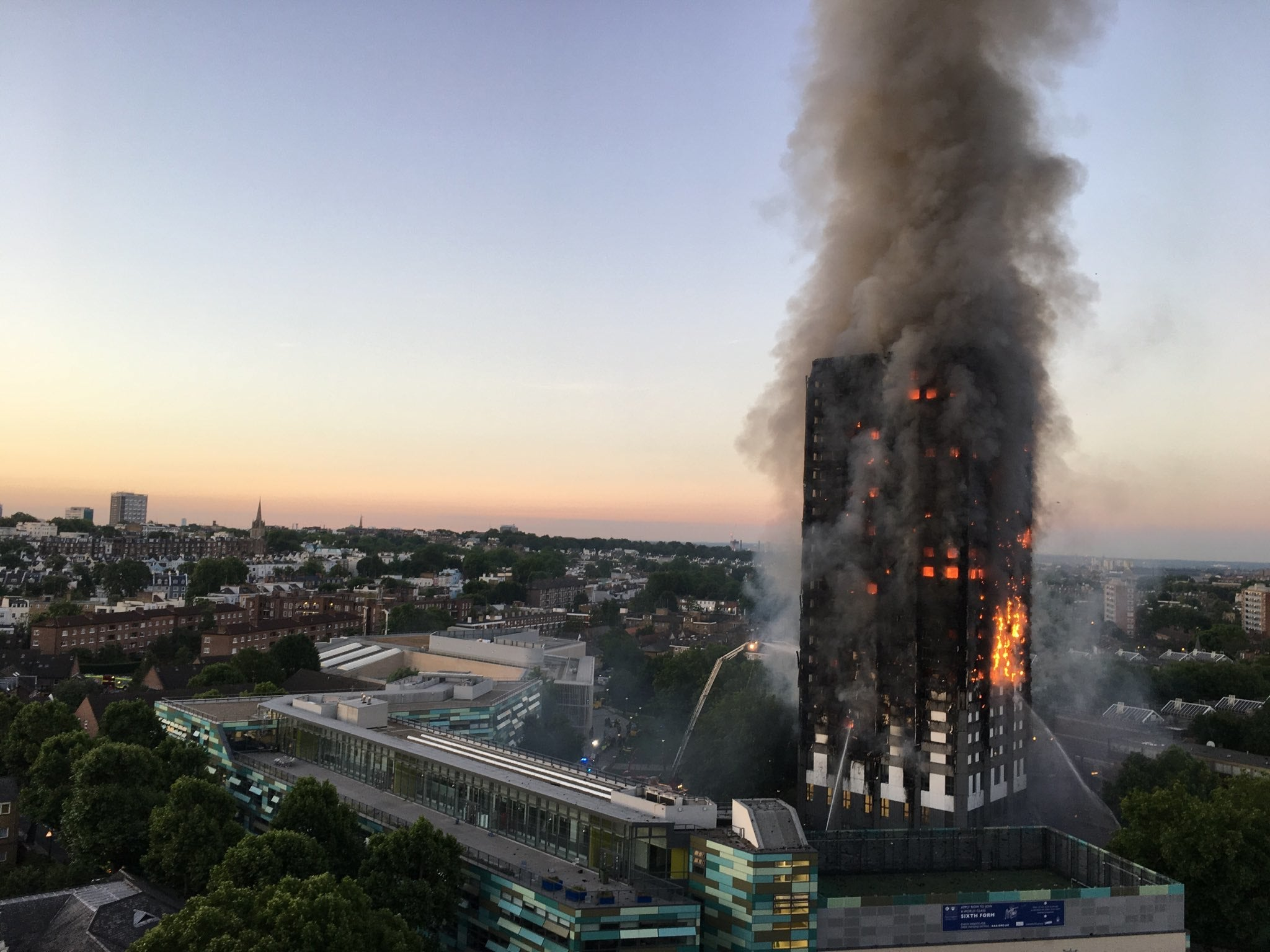 Firefighters try to pout out the blaze at Grenfell Tower
