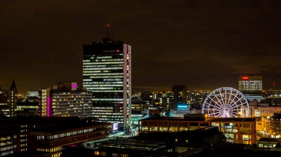A picture of the city of Manchester, taken at night