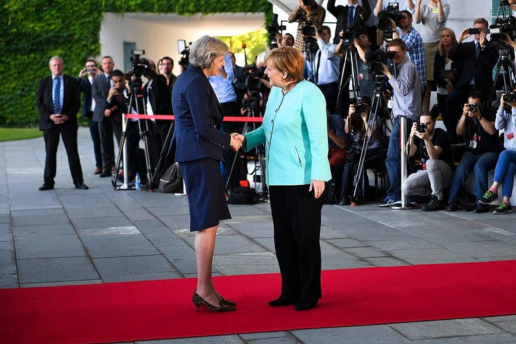 Theresa May and Angela Merkel meet and shake hands