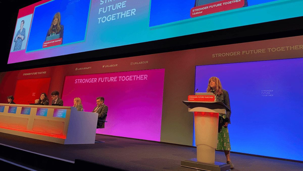 TSSA delegate Fliss Premru speaking from the stage at Labour Conference 2021