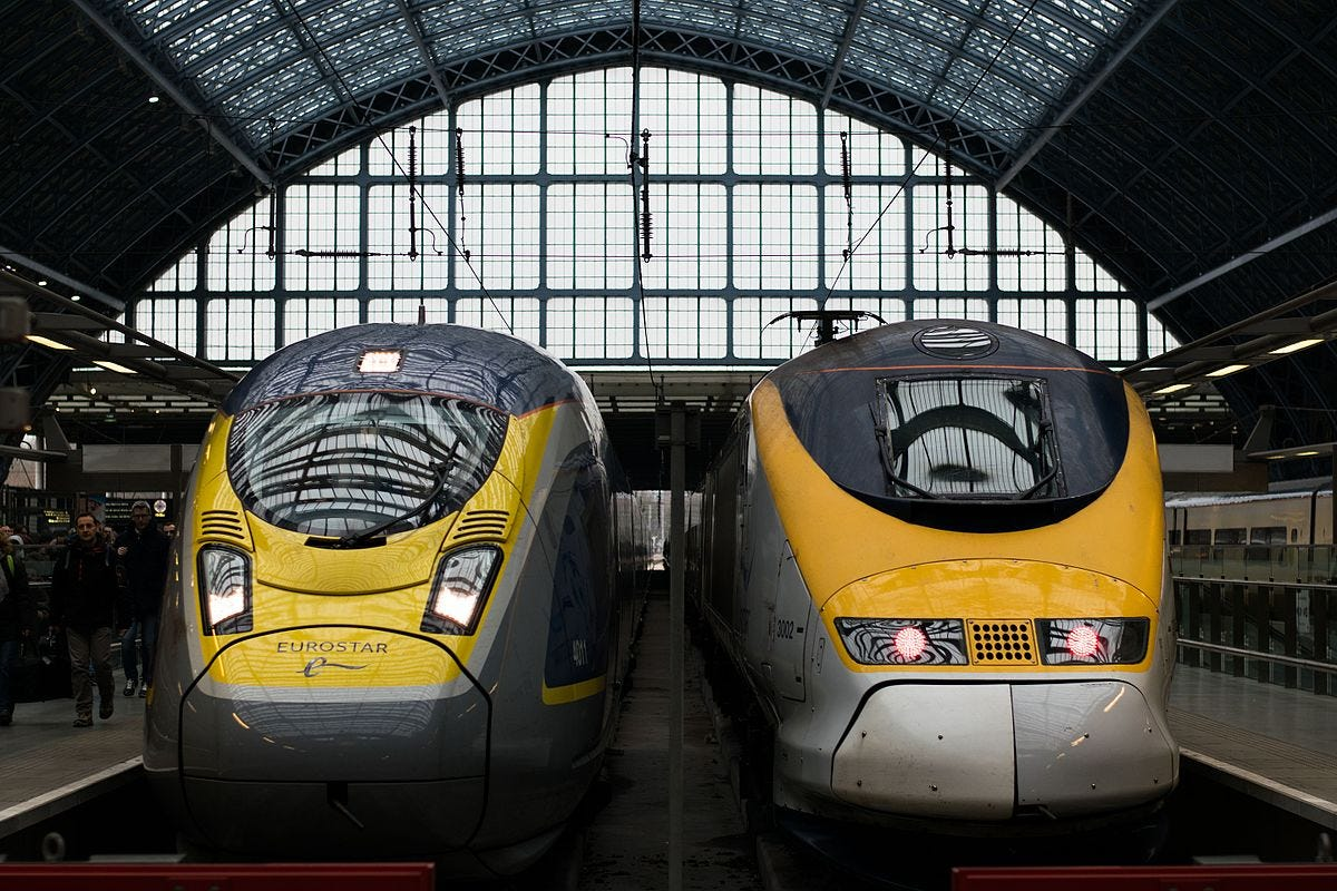 Two Eurostar trains in a station