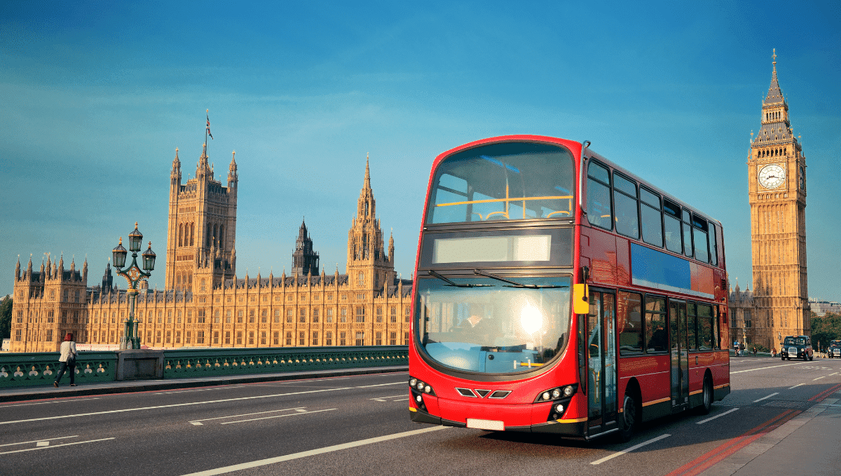 Red double decker London bus in front of parliament
