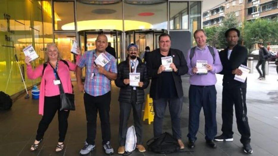 Transport for London TSSA members outside TfL building with Manuel Cortes holding leaflets