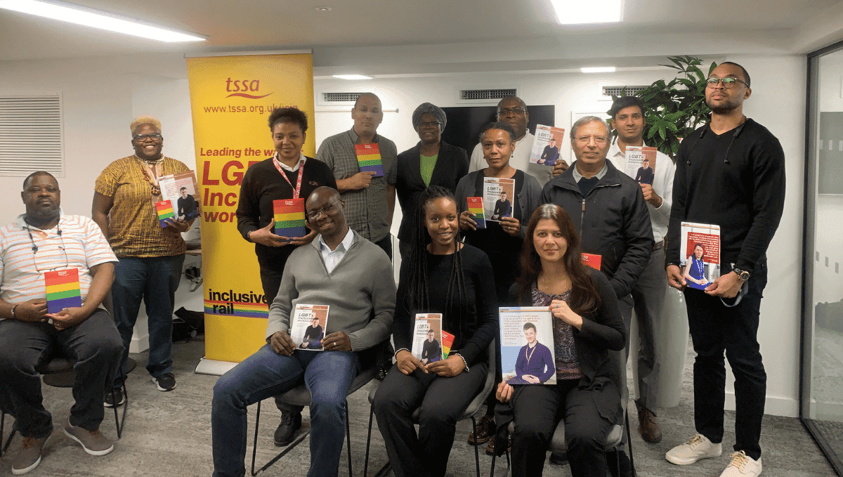 Photo of TSSA Emix group holding Stonewall LGBT meeting materials