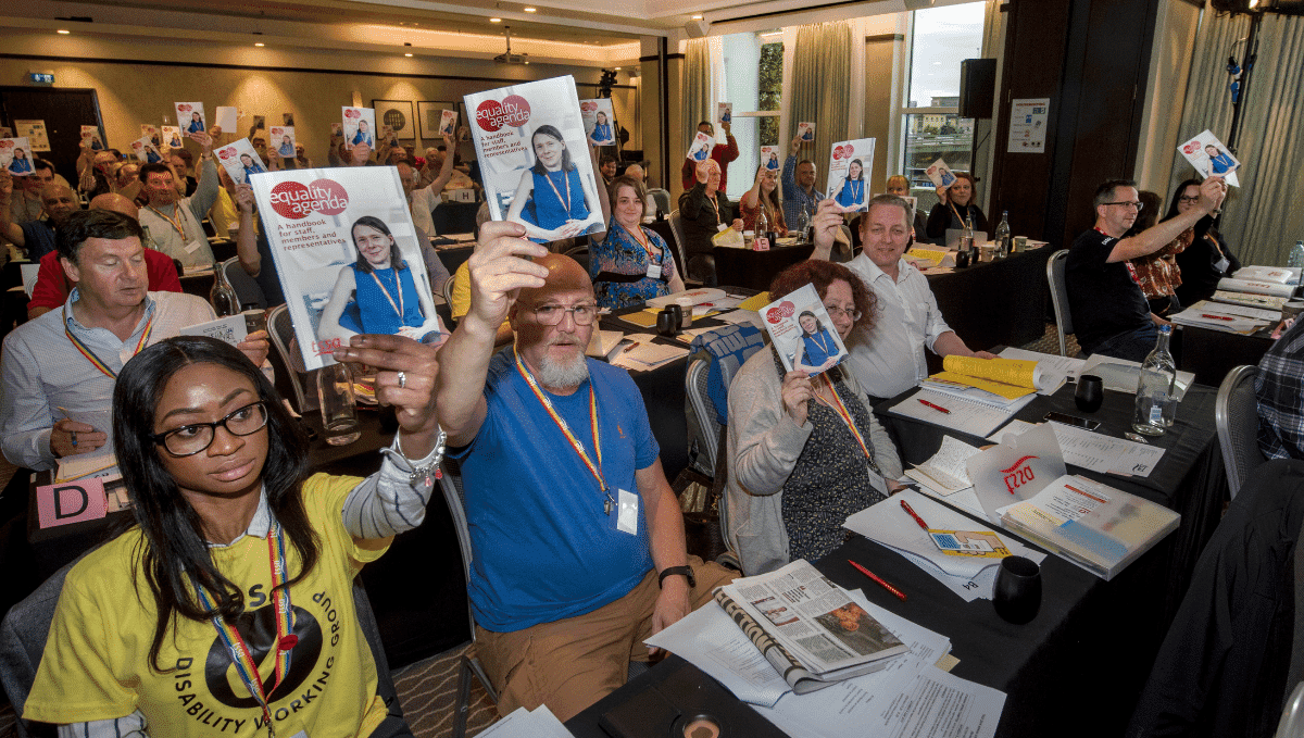 TSSA conference delegates holding up equality agenda booklets