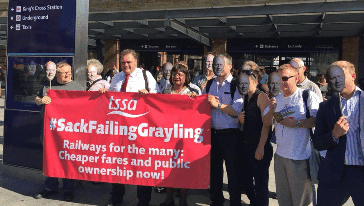 TSSA campaigners including Manuel Cortes and Diane Abbott MP with banner saying 'Sack Failing Grayling'