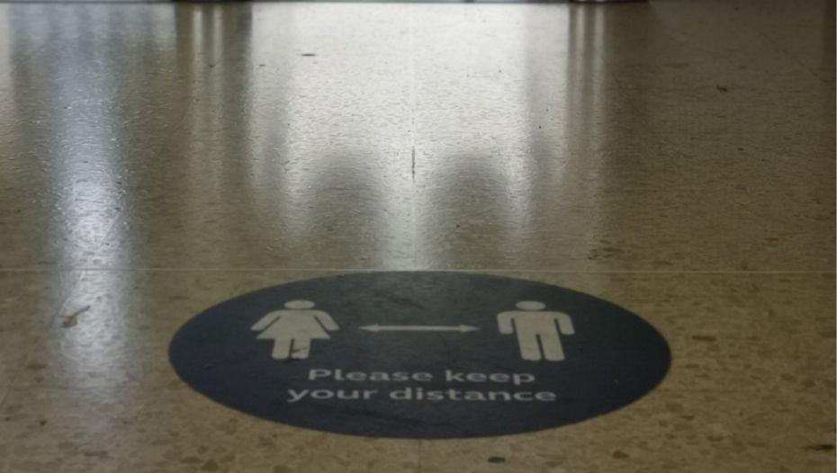 Please keep your distance floor sign