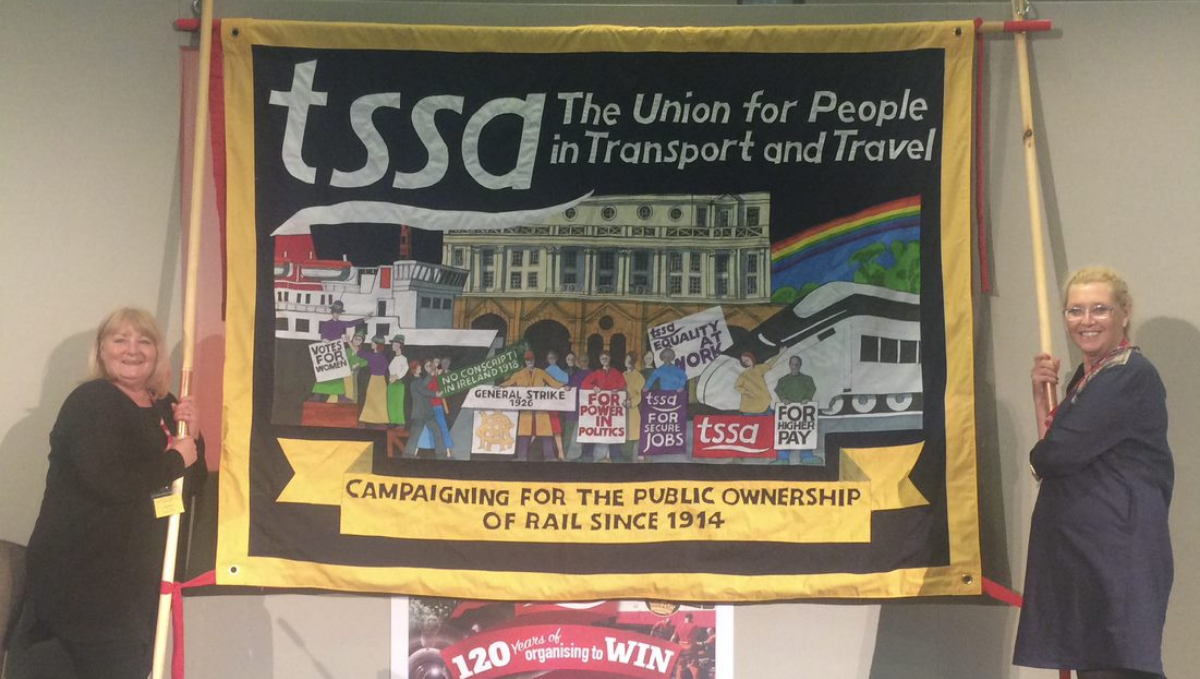 TSSA banner being held by two women