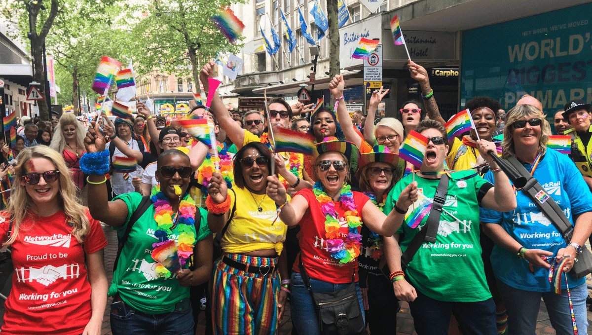 Colourful group of people from Network Rail LGBT+ at Pride festival