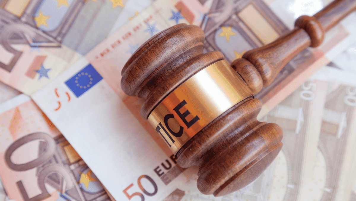 Judge's hammer on top of Euro bank notes