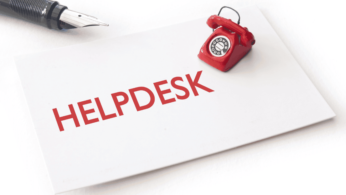 Card saying 'helpdesk' with red phone and pen