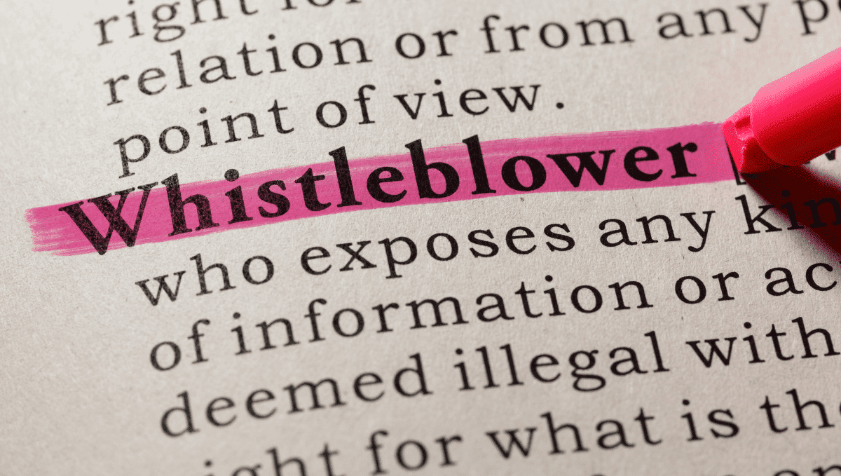 Close up of the word 'Whistleblower' in a dictionary definition