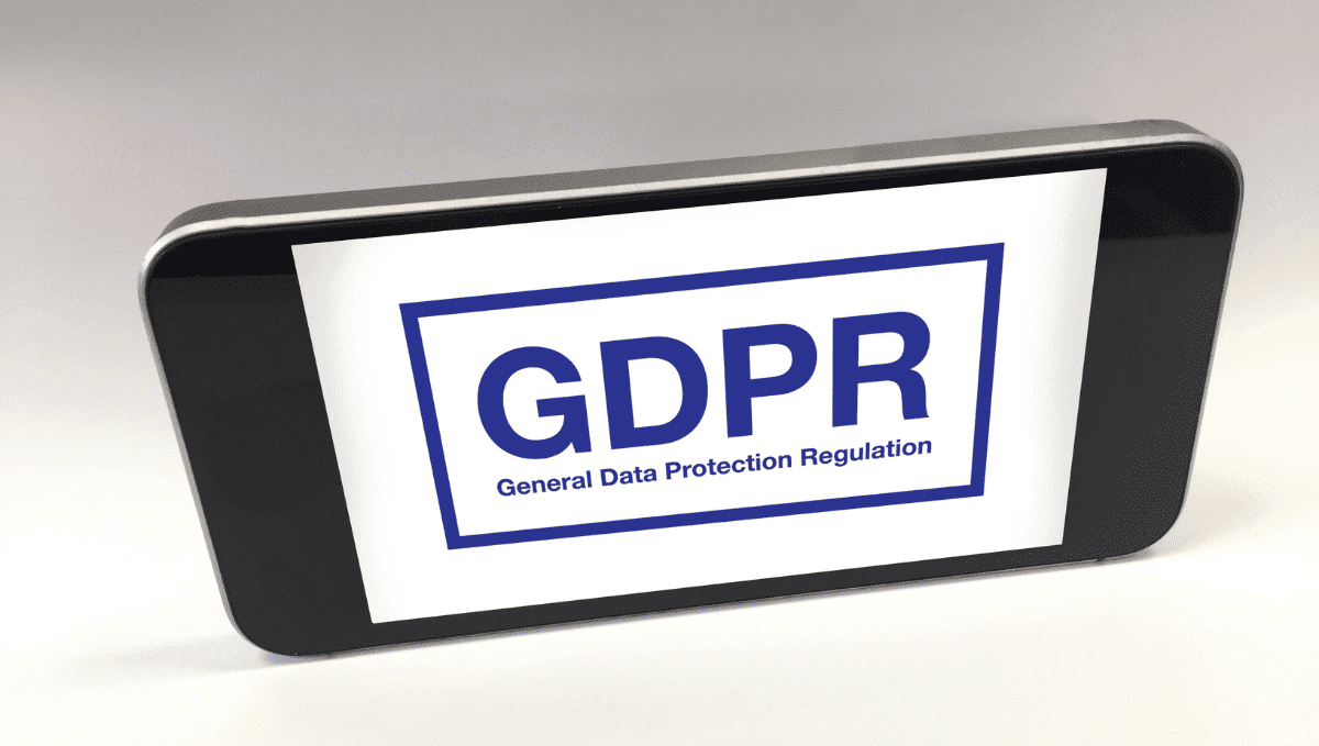 Smart phone screen with the acronym 'GDPR' and words: General Data Protection Regulations