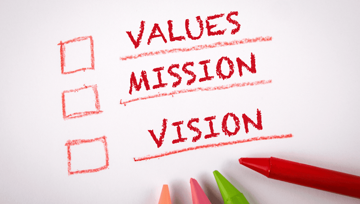 Mission, vision, values written in red crayon