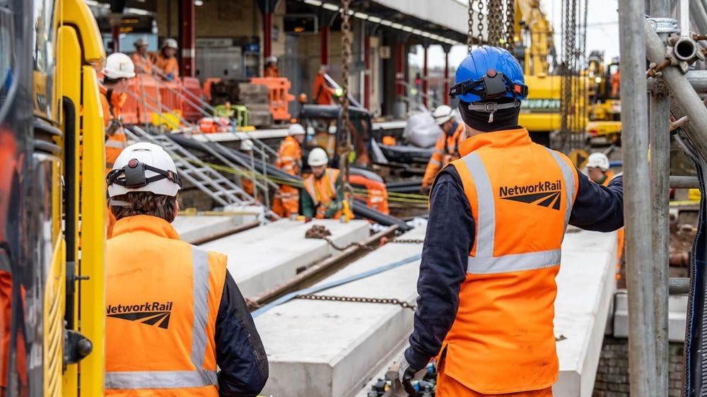 Network Rail engineers in high vis and hard hats at Warrington Bank Quay station