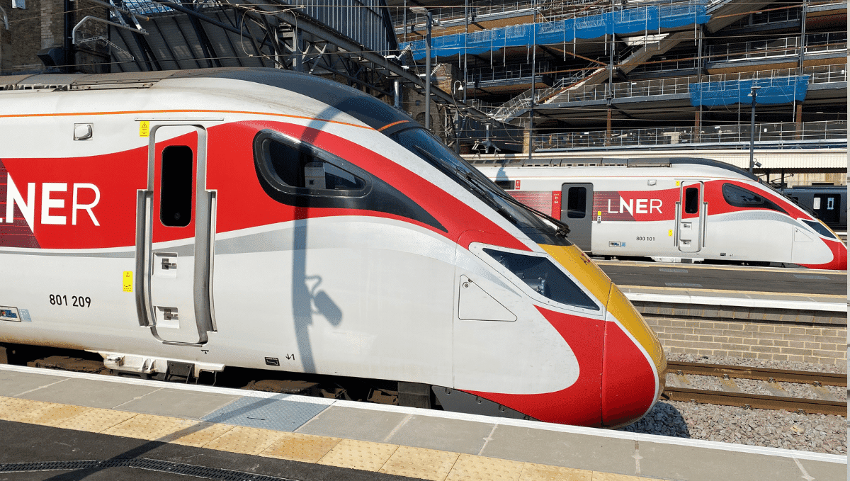 Two LNER trains at platforms in Kings Cross station