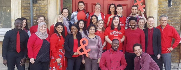 A group of DKMS staff wearing red to celebrate World Blood Cancer Day