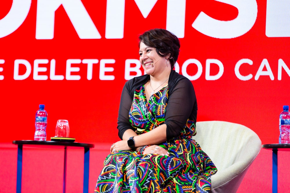 Alana James Country Executive Director DKMS Africa seated at launch event