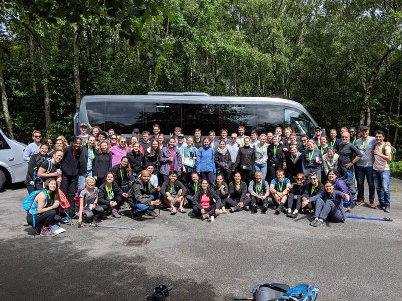 Go Cardless employees undertook the Three Peaks challenge to raise money for DKMS - Image shows a group of people from Go Cardless gathered in front of a coach