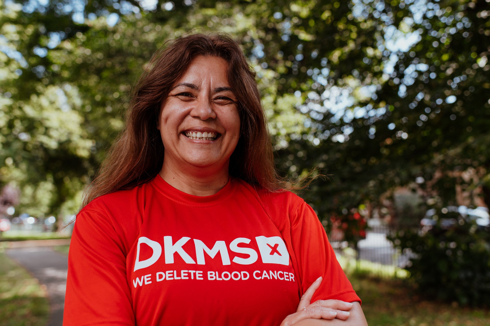 Flora, one of our fundraisers, proudly wearing her red DKMS t-shirt.