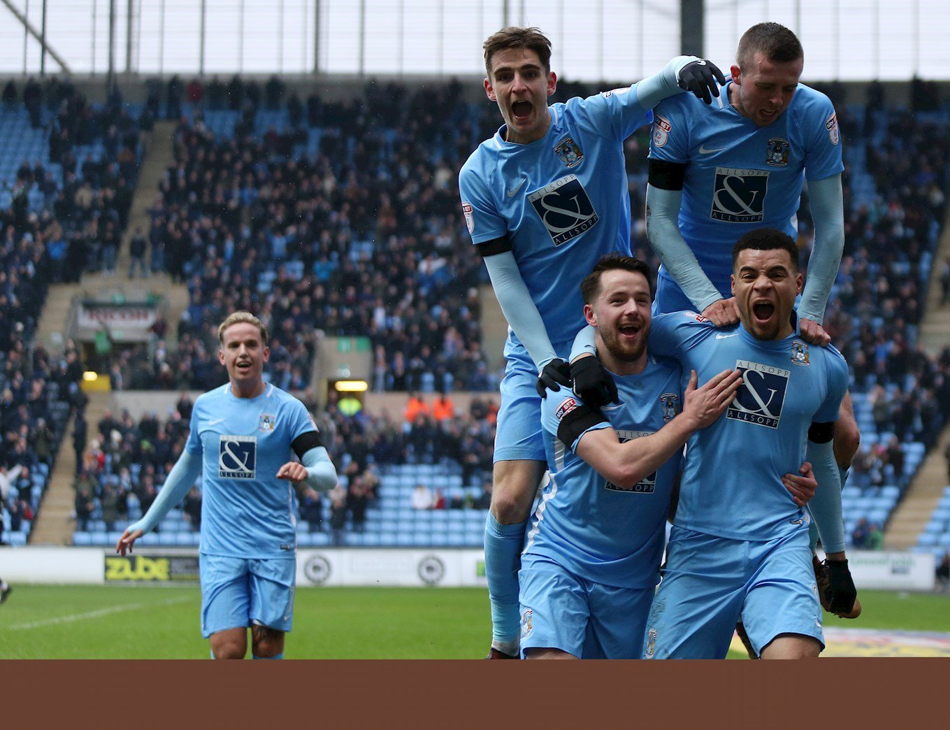 Jubilent Coventry City players celebrate goal Against Swindon Town