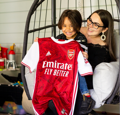 Ryan Brissett shows off signed Arsenal t-shirt