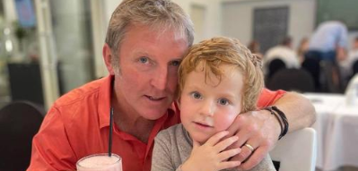 Image of Gary Stevens hugging son Jack