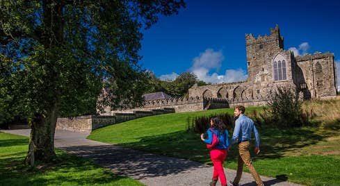 Couple walking through the gardens of Tintern Abbey Saltmills Co. Wexford