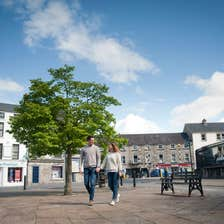 Image of a couple walking through Monaghan Town in County Monaghan