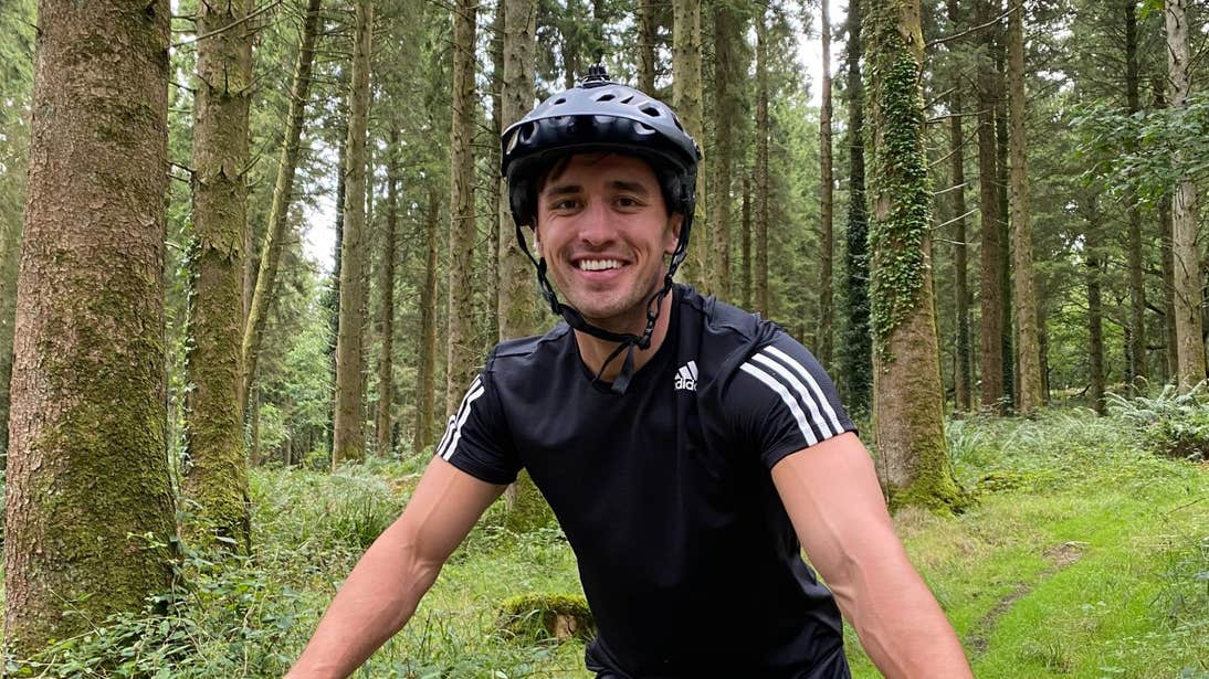 Greg O'Shea surrounded by trees while mountain biking in Offaly