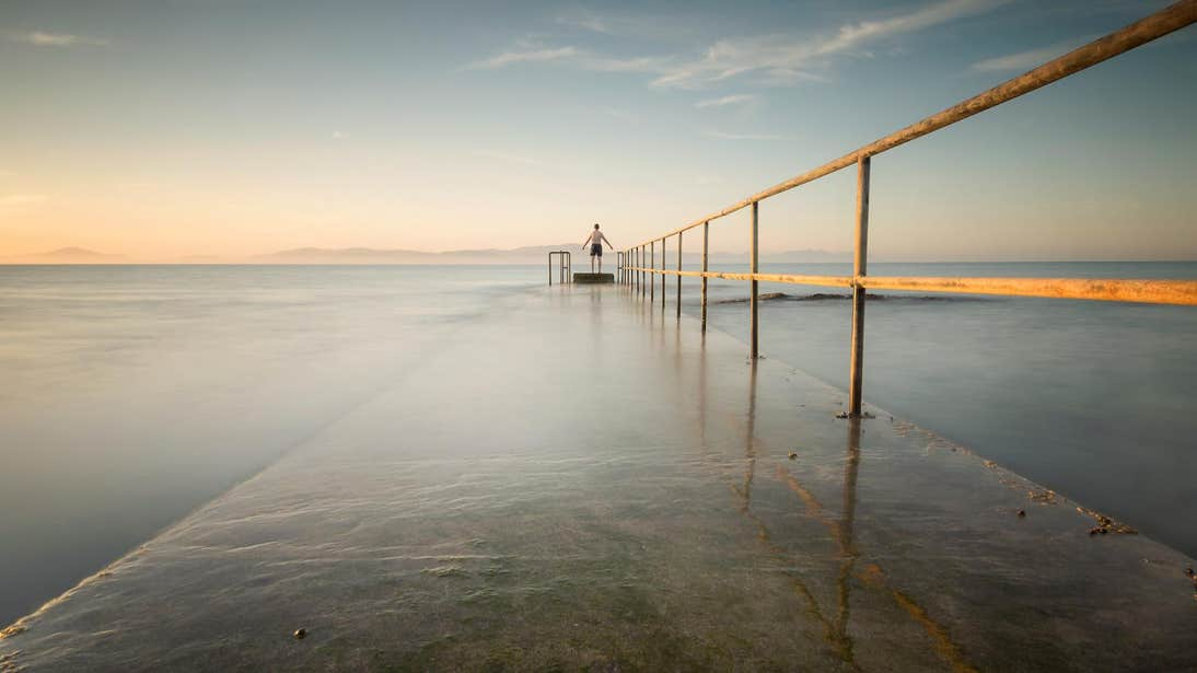 Person standing at the end of Salterstown Pier in Louth on a misty morning