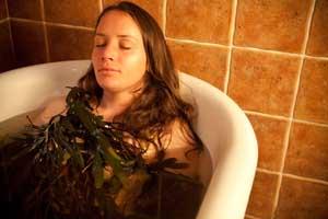 Image of lady in seaweed bath