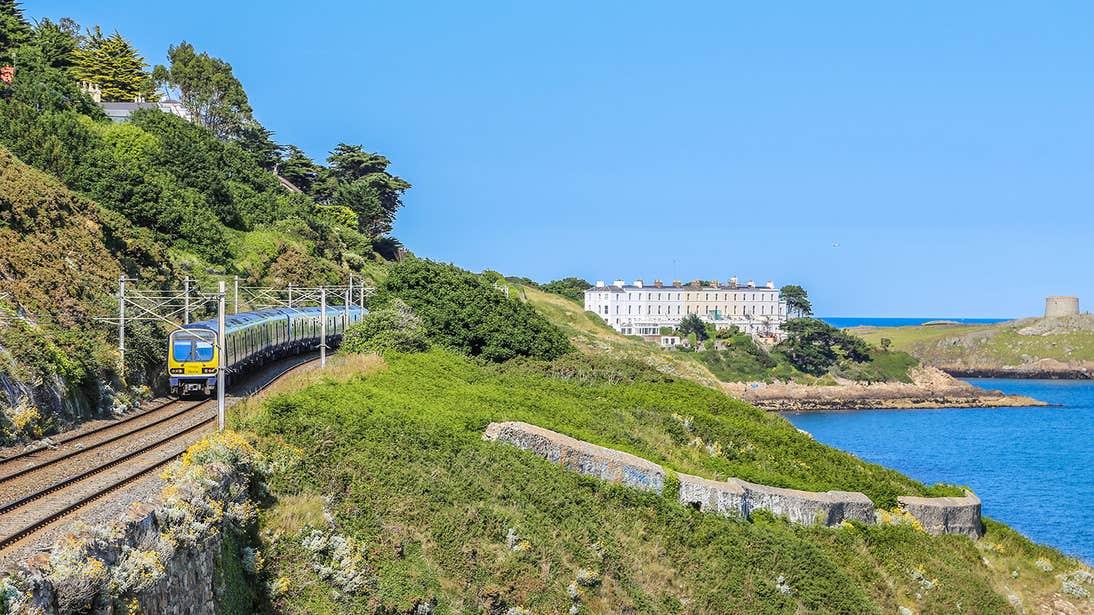 The Dart train going by the sea in Killiney in Dublin