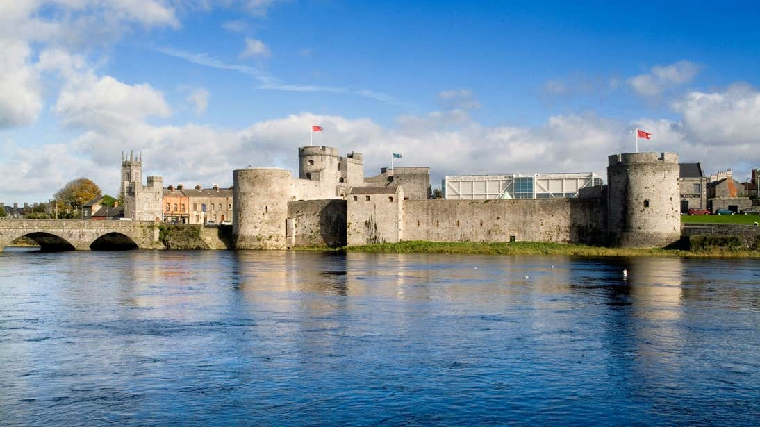 Blue skies with flags blowing at King John's Castle, Co. Limerick