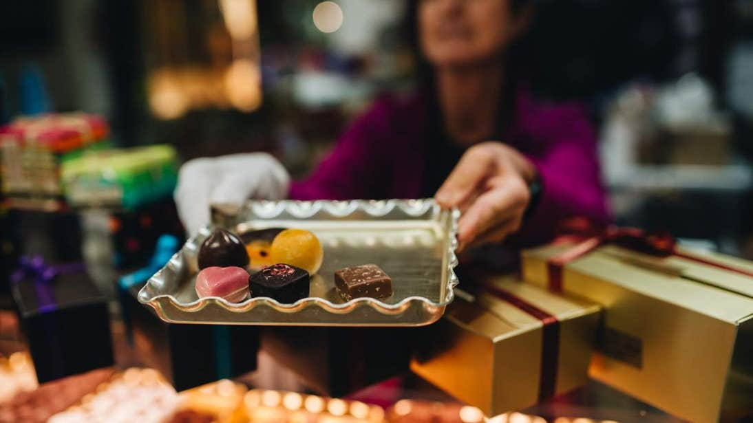 Woman holding a tray of chocolates at The English Market in Cork.