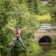 Image of a woman ziplining in Castlecomer Discovery Park in County Kerry