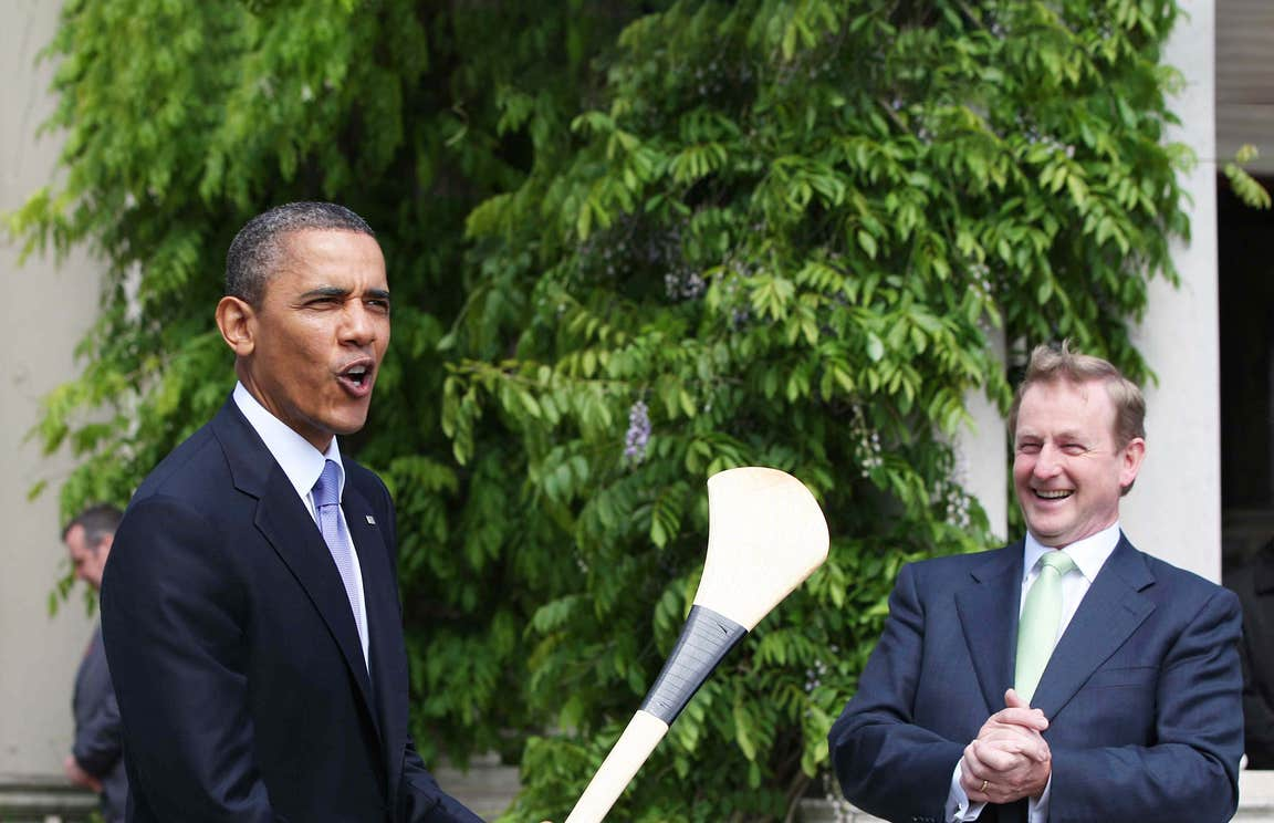 Barack Obama posing with a hurl alongside former Taoiseach Enda Kenny during his visit to Ireland in 2011