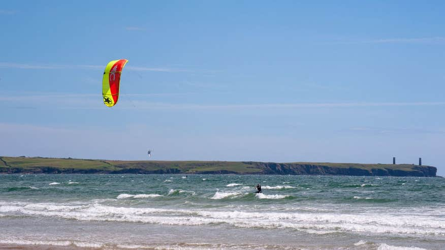 Kitesurfers can be seen all year on Tramore Beach.