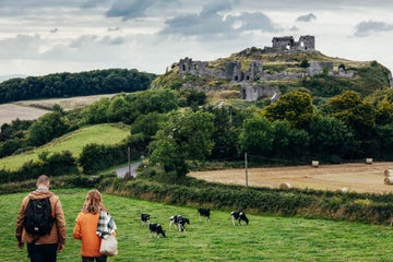 People walking towards the Rock of Dunamase in Portlaoise in County Laois