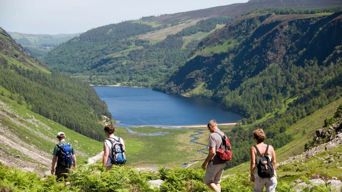 A group hiking across mountains at Glendalough, Co Wicklow